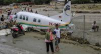 A plane is seen after being dragged from its hangar in flooding in Jayapura, Papua on Sunday. (Antara/Gusti Tanati)
