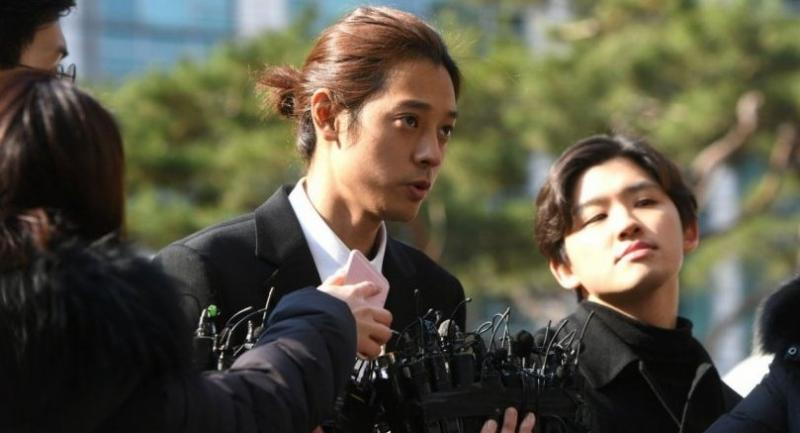 K-pop star Jung Joon-young (C) speaks to the media as he arrives for questioning at the Seoul Metropolitan Police Agency in Seoul on March 14.//AFP