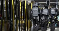Police forces walk near a tram at the 24 Oktoberplace in Utrecht, on March 18, 2019 where a shooting took place. //AFP