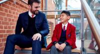 Thomas Banyard, the founding head of King's College International School Bangkok, talks to a student at King's College School in London.