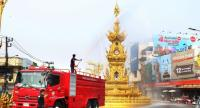 A fire truck sprays water near Chiang Rai's landmark clock tower to reduce the toxic level of PM2.5 air pollution that is choking the city.