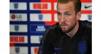 England's striker Harry Kane speaks during a press conference at St George's Park in Burton-on-Trent. / AFP