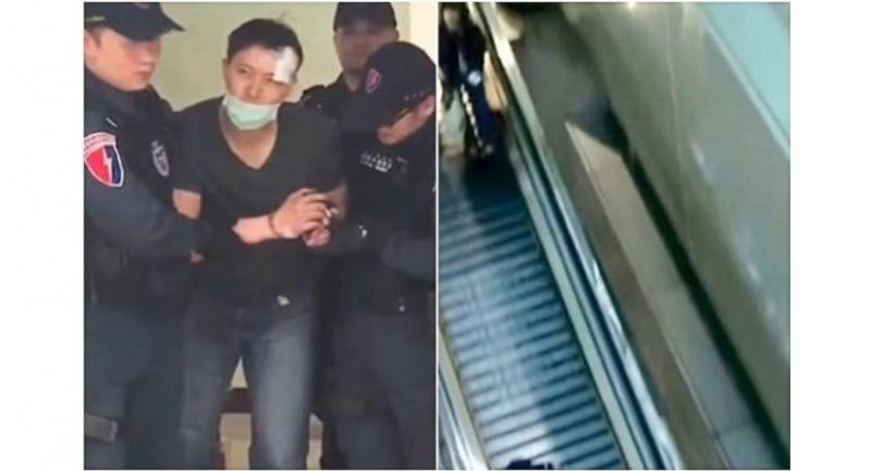 Under investigation: Police escorting Wan. (Right) The stairway from where Chang was thrown at Taiwan's Taoyuan International Airport.//Photo : The Straits Times/Asia News Network