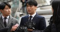 Seungri (C), a member of the K-pop boy group BIGBANG, speaks to the media as he arrives for questioning over criminal allegations at the Seoul Metropolitan Police Agency in Seoul on March 14.//AFP