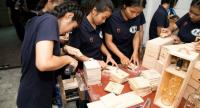 """Students member of Skill for Life foundation are working go do """"Botlight"""" one of products generating income for teenagers through the Skills for Life foundation."""