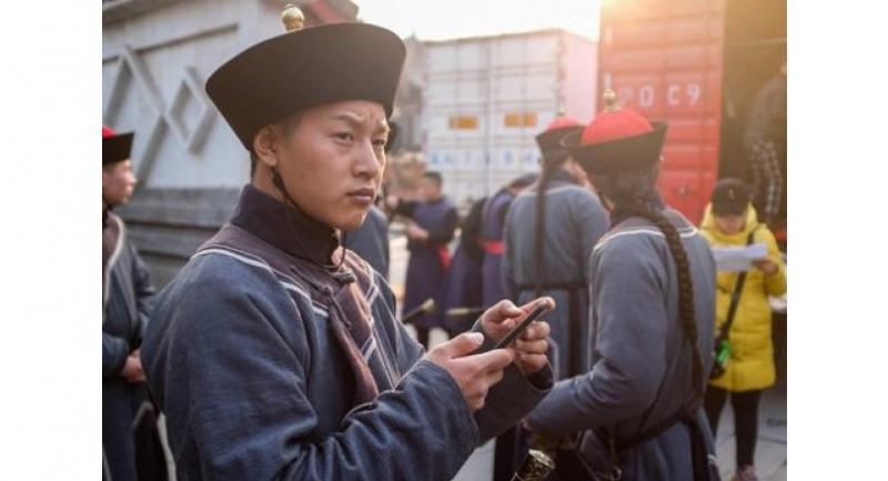 Extras dressed in period costume take a break during filming for a Chinese TV drama at Hengdian World Studios in Dongyang in China's eastern Zhejiang province.