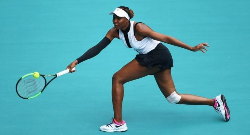 Venus Williams of USA in action against Dalila Jakupovic of Slovenia. / AFP