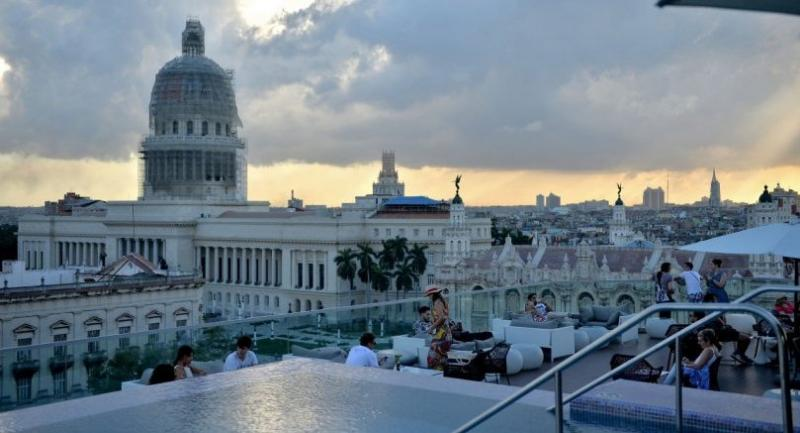 The swimming pool on the rooftop of the Gran Manzana Hotel in Havana is a tourist magnet.