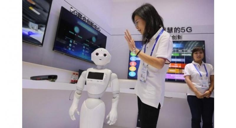 A 5G enabled robot from China Mobile on display at a high-tech expo in Shenzhen, Guangdong province.