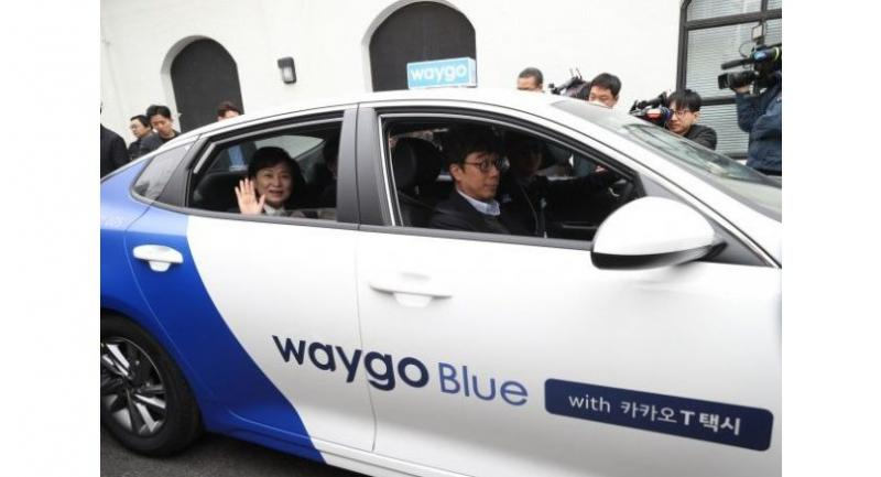South Korean Transportation Minister Kim Hyun-mee (back seat) takes a ride on Waygo Blue at a launch event held in Seoul, Wednesday.
