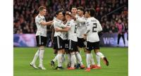 Germany's players celebrate after scoring during the UEFA Euro 2020 Group C qualification football match between The Netherlands and Germany.