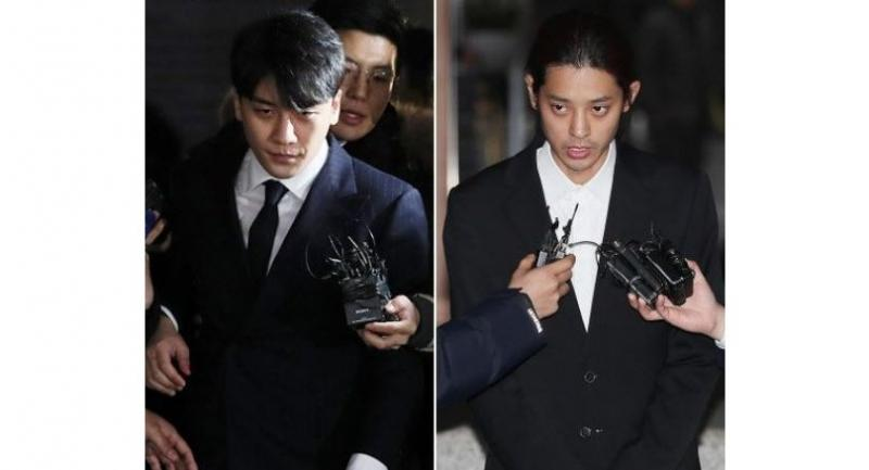 Seungri (left) Jung Joon-young were arrested in connection with much-publicised sex-drug scandal.(Yonhap)