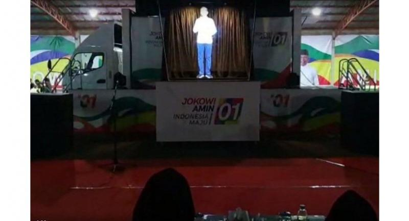 Indonesian President Joko Widodo's national victory team (TKN) shows a hologram of Joko Widodo during an election campaign in Jakarta.//AFP