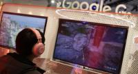 Attendees play games on the new Stadia gaming platform at the Google booth at the 2019 GDC Game Developers Conference on March 20, 2019 in San Francisco, California. The GDC runs through March 22./AFP