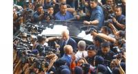 Najib appears at the Kuala Lumpur court complex in relation to his charges over the RM42bil corruption trial on Oct 4,2018. – KAMARUL ARRIFINI/The Star