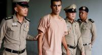 File photo : Bahraini soccer player with Australian refugee status Hakeem Al-Araibi (2-L) is escorted out of court by Thai prison officers following an extradition hearing at the Criminal Court in Bangkok on February 4.//EPA-EFE