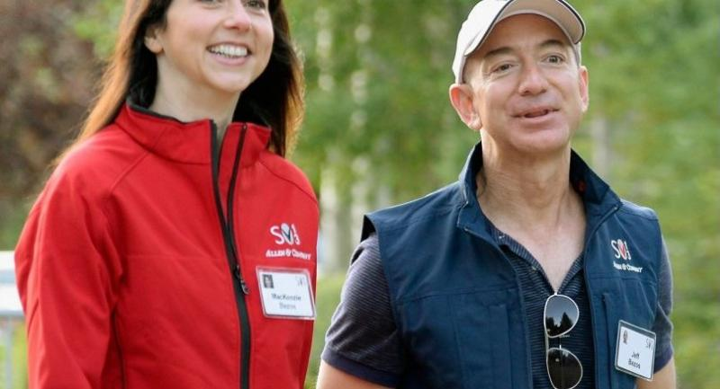 In this file photo taken on July 10, 2013, Jeff Bezos, founder and CEO Amazon.com, and his wife Mackenzie Bezos arrive for morning session of the Allen