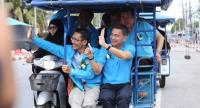 Former Democrat party leader Abhisit Vejjajiva, right,  during an election campaign last month.