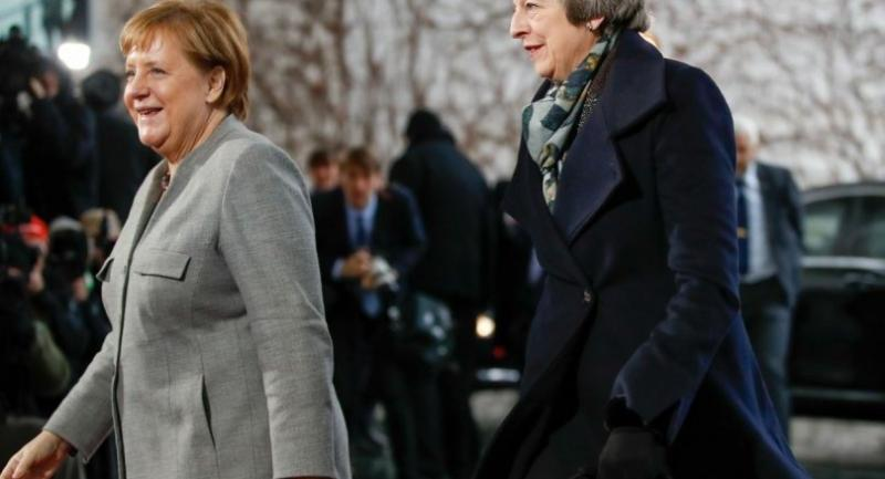 In this file photo taken on December 11, 2018 German Chancellor Angela Merkel (L) precedes British Prime Minister Theresa May after greeting her at the Chancellery in Berlin.//AFP