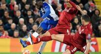 Porto's Malian striker Moussa Marega (rear L) vies for the ball with Liverpool's Dutch defender Virgil van Dijk (C) and Liverpool's Croatian defender Dejan Lovren (front R).