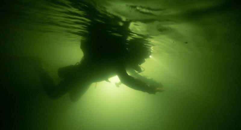 This handout photo taken on April 3, 2019 and released by Oxalis Adventure Tours on April 9, 2019 shows a diver swimming underwater during an expedition in Vietnam's Son Doong cave.//AFP
