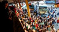 Bangkok bus terminals see increasing crowds of people leaving the capital for the provinces to celebrate the traditional Songkran New Year this weekend.