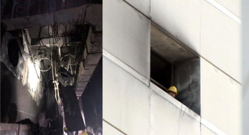 An investigation team inspects damage from Wednesday's fire at the CentralWorld complex in Bangkok yesterday.