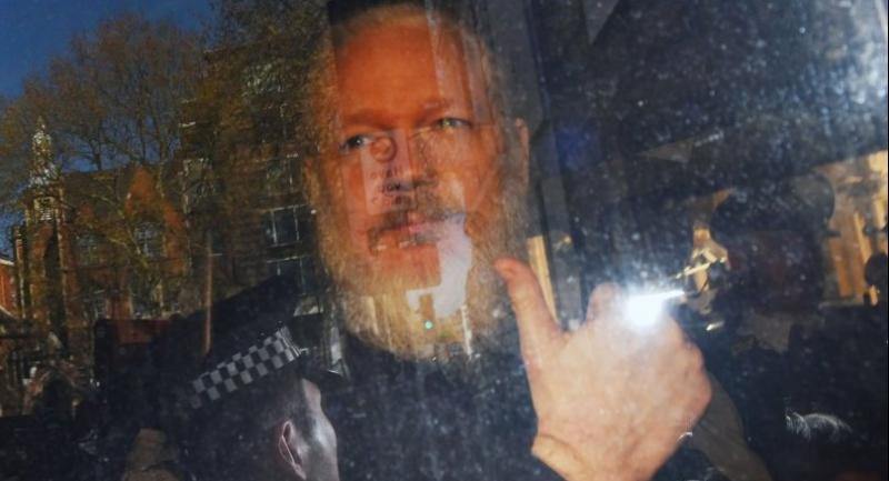 Wikileaks co-founder Julian Assange arrives at Westminster Magistrates Court in London, Britain, on April 11.//EPA-EFE