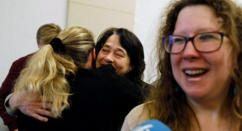 Parents and donor children react after the ruling in the case in which they demanded the DNA of sperm doctor Jan Karbaat be compared with their DNA, to obtain the ultimate certainty that he was indeed their biological father, on February 13.//EPA-EFE