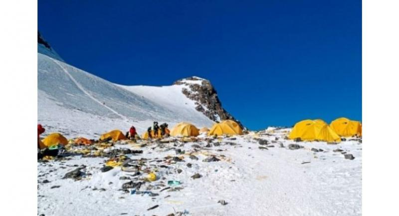 Ghastly sight: Rubbish scattered around Camp 4 of Mount Everest. But climbers with pressing needs will soon find an 'eco-friendly' toilet at a Chinese campsite.//AFP