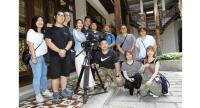 The Hong Kong crew posing for a photo with Wong (light blue kebaya) and Lai (on Wong's left) after filming a scene at the Kebaya Dining Room of Seven Terraces in George Town. – Photos: LIM BENG TATT/The Star