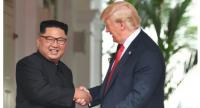 File photo of Trump and Kim shaking hands during their June 12 summit in Singapore in 2018.//AFP