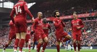 Liverpool's Egyptian midfielder Mohamed Salah (C) celebrates with teammates after scoring their second goal. / AFP