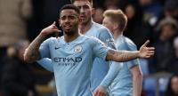 Manchester City's Brazilian striker Gabriel Jesus celebrates after scoring their third goal.