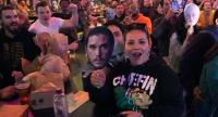 Game of Thrones fans hold up masks as they wait for the start of the 'Game of Thrones' premiere party at the Understudy bar in Brooklyn in New York on April 14, 2019. This is the final season for the HBO show. //AFP