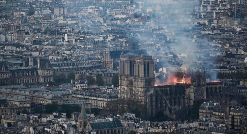 Smoke and flames rise during a fire at the landmark Notre-Dame Cathedral in central Paris on April 15, 2019, potentially involving renovation works being carried out at the site, the fire service said./AFP