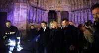 French President Emmanuel Macron (C) and his wife Brigitte Macron (R) pay a visit to firemen fighting against a fire burning the roof of the Notre-Dame cathedral in Paris, France, on April 15.//EPA-EFE