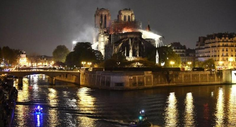 French firemen spray water to extinguish a fire as flames are burning the roof of the Notre-Dame Cathedral in Paris, France, 15 April 2019. A fire started in the late afternoon in one of the most visited monuments of the French capital.//EPA-EFE