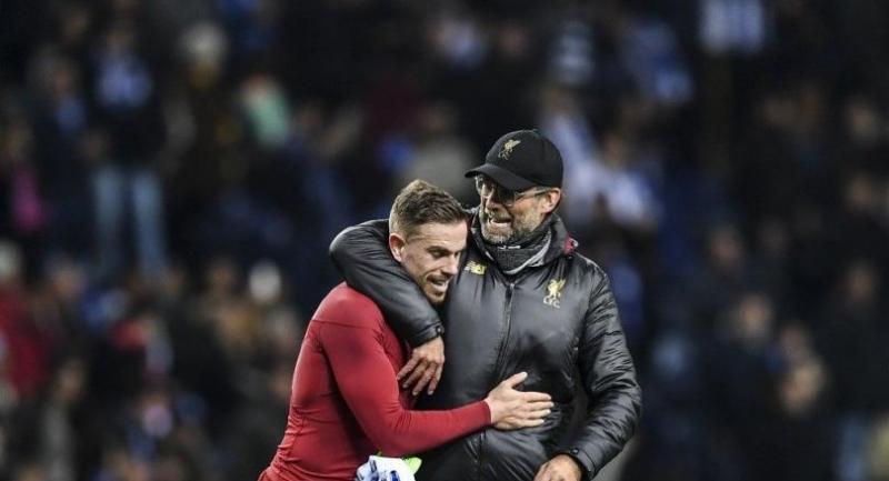 Jordan Henderson (L) celebrates with Liverpool's German coach Jurgen Klopp their win.