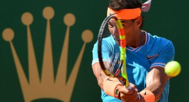Spain's Rafael Nadal plays a backhand return Spain's Roberto Bautista Agut. / AFP