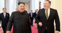 This file photo shows North Korea's leader Kim Jong Un (L) greeting US Secretary of State Mike Pompeo (R) at the Paekhwawon State Guesthouse in Pyongyang in October, 2018.//AFP