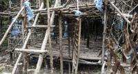 Abandoned migrant camp used by people-smugglers are seen in a jungle at Bukit Wang Burma in the Malaysian northern state of Perlis, which borders Thailand, on May 26, 2015.//AFP