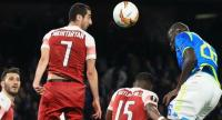 Arsenal's Armenian midfielder Henrikh Mkhitaryan (L) and Napoli's Senegalese defender Kalidou Koulibaly (R) go for a header during the UEFA Europa League quarter-final second leg.