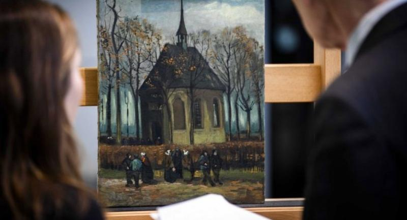 """The painting """"Congregation Leaving the Reformed Church in Nuenen"""" (1885) by Vincent van Gogh (1853  1890) back on display in the permanent collection of the Van Gogh Museum in Amsterdam. /EPA-EFE"""