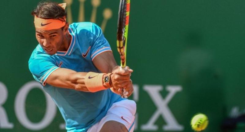 Spain's Rafael Nadal hits a return to Argentina's Guido Pella. / AFP