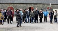Game of Thrones fans listen to a presentation as they visit the Castle Ward Estate in Strangford, northern Ireland, on April 17, 2019 the location of Winterfell in Game of Thrones, and one of the many locations used by the hit HBO show./AFP