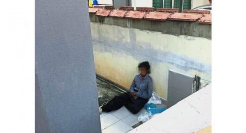 A picture of the allegedly abused maid sitting at the porch of the house.//The Star/ANN