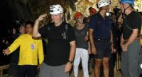 Members of the Thai cave rescue team, Australian doctors and divers Richard Harris (3-L) and Craig Challen (2-R) enter Tham Luang cave in Mae Sai district, Chiang Rai province, Thailand, 22 April 2019. // EPA-EFE PHOTO