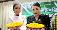Gamhom Nalanchang, alias Kanja Witch, right, and former Miss Thailand World title holder Chanakarn Chaisri, present traditional Thai sweets at a press conference in Ramkhamhaeng University yesterday.