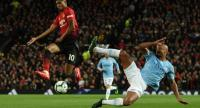 Manchester City's Belgian defender Vincent Kompany (R) vies with Manchester United's English forward Marcus Rashford. / AFP